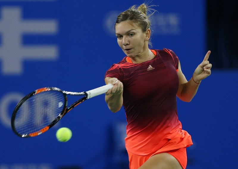 WUHAN, CHINA - SEPTEMBER 29: Simona Halep of Romania returns a shot during the match against Anastasia Pavlyuchenkova of Russia on Day 3 of 2015 Dongfeng Motor Wuhan Open at Optics Valley International Tennis Center on September 29, 2015 in Wuhan, China. (Photo by Zhong Zhi/Getty Images)