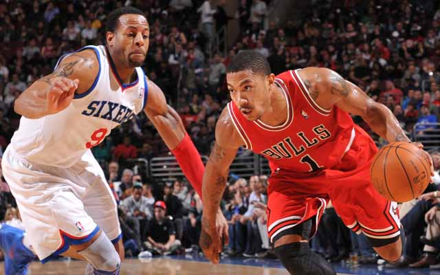 PHILADELPHIA, PA - FEBRUARY 1: Derrick Rose #1 of the Chicago Bulls drives against Andre Iguodala #9 of the Philadelphia 76ers during the game on February 1, 2012 at the Wells Fargo Center in Philadelphia, Pennsylvania.  NOTE TO USER: User expressly acknowledges and agrees that, by downloading and/or using this Photograph, user is consenting to the terms and conditions of the Getty Images License Agreement. Mandatory Copyright Notice: Copyright 2012 NBAE   (Photo by David Dow/NBAE via Getty Images)